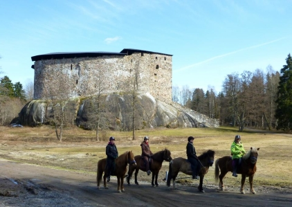 Pausing by Raasepori Castle during our two-day trek to the organic farm Bovik.